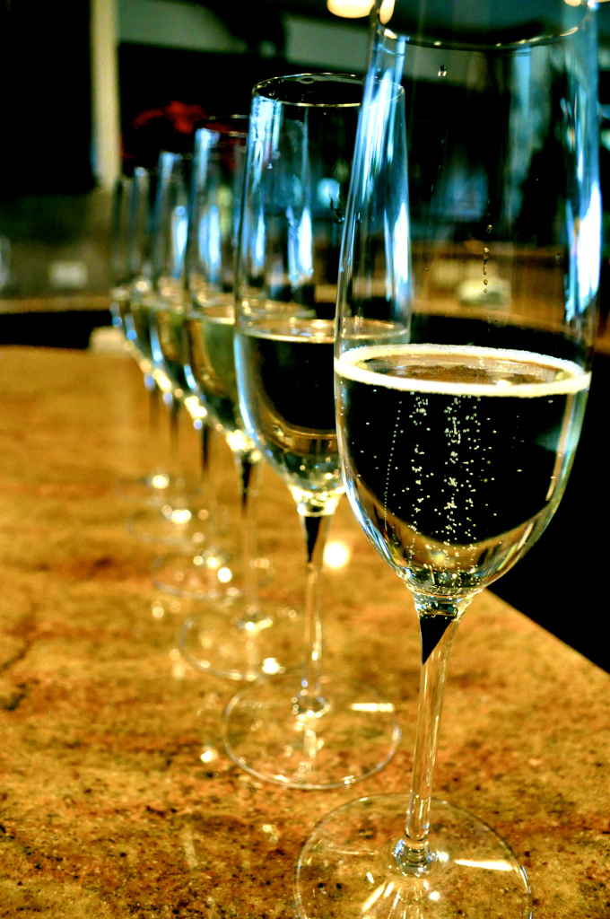 a line of full champagne glasses ready for the new year