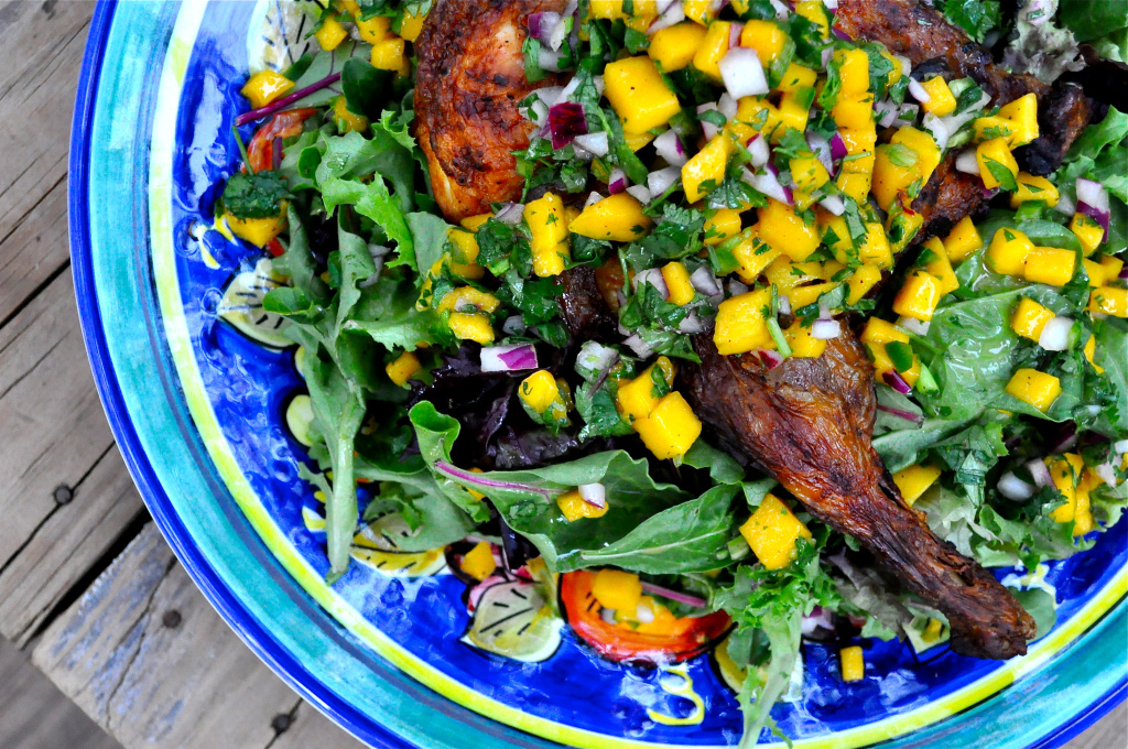 mango salsa on top of chicken and salad