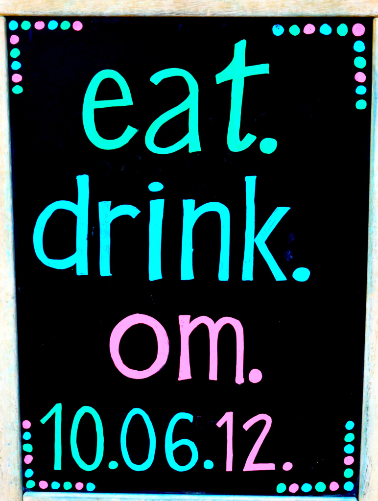 "chalkboard sign that says ""eat.drink.om."" with the date 10.06.12 on it"