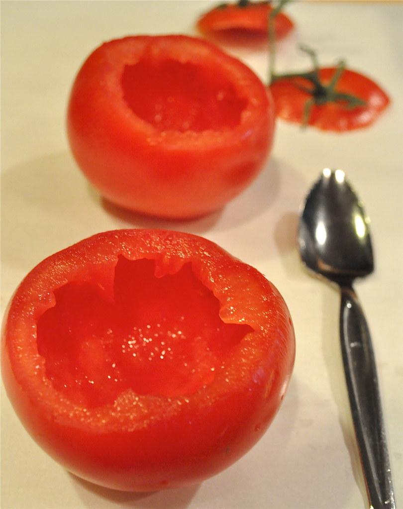 two hollowed out tomatoes