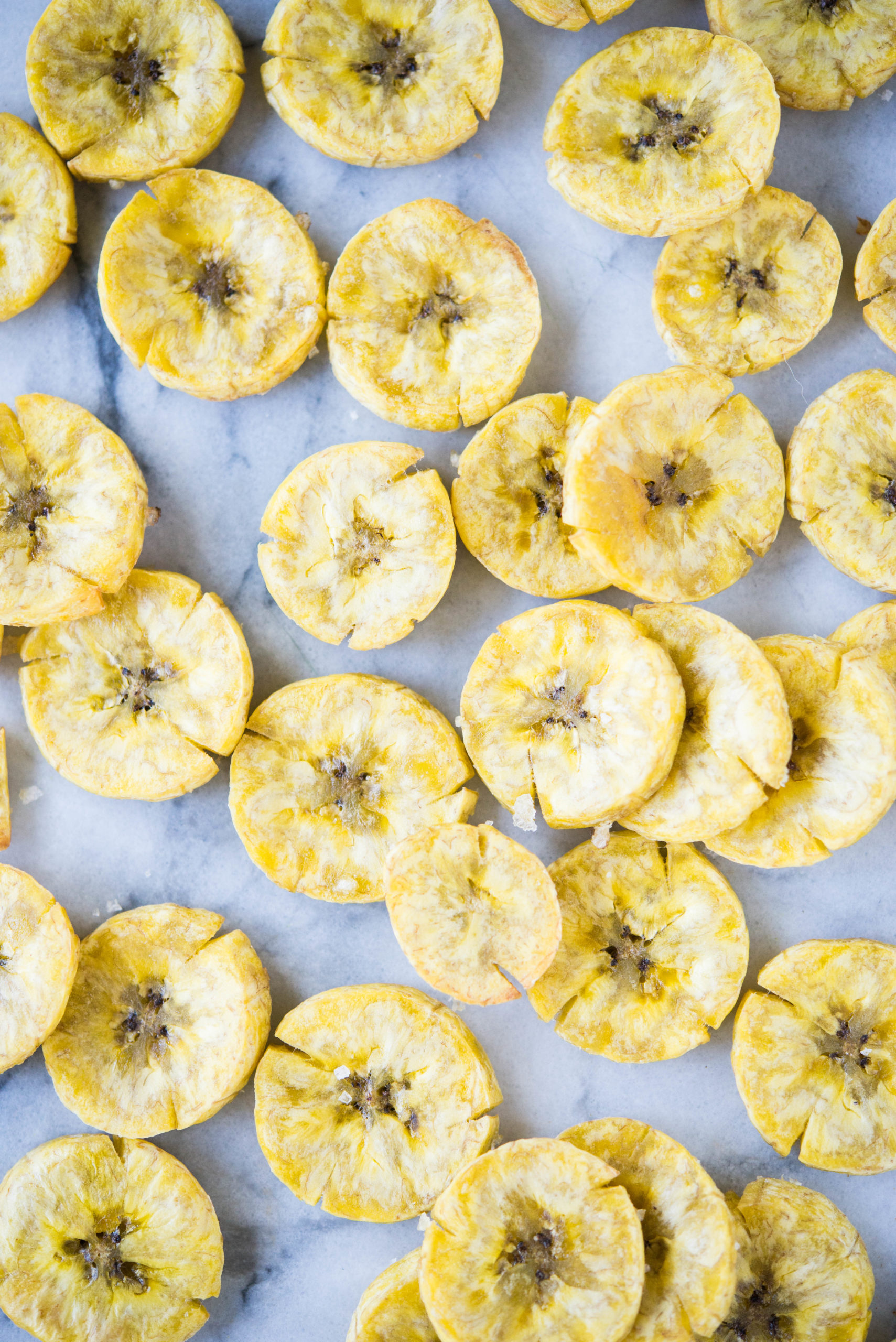 plantain chips on a marble board
