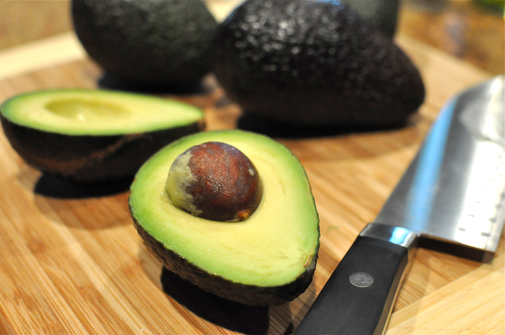 Avocado cut in half for Paleo Stuffed Avocados with Cilantro Lime Cream Sauce
