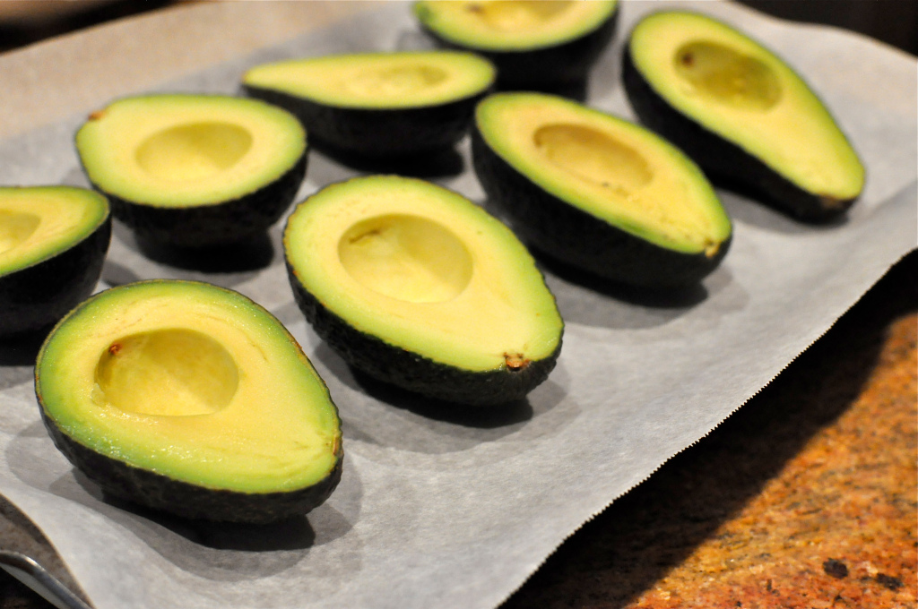 Halved avocados for Paleo Stuffed Avocados with Cilantro Lime Cream Sauce