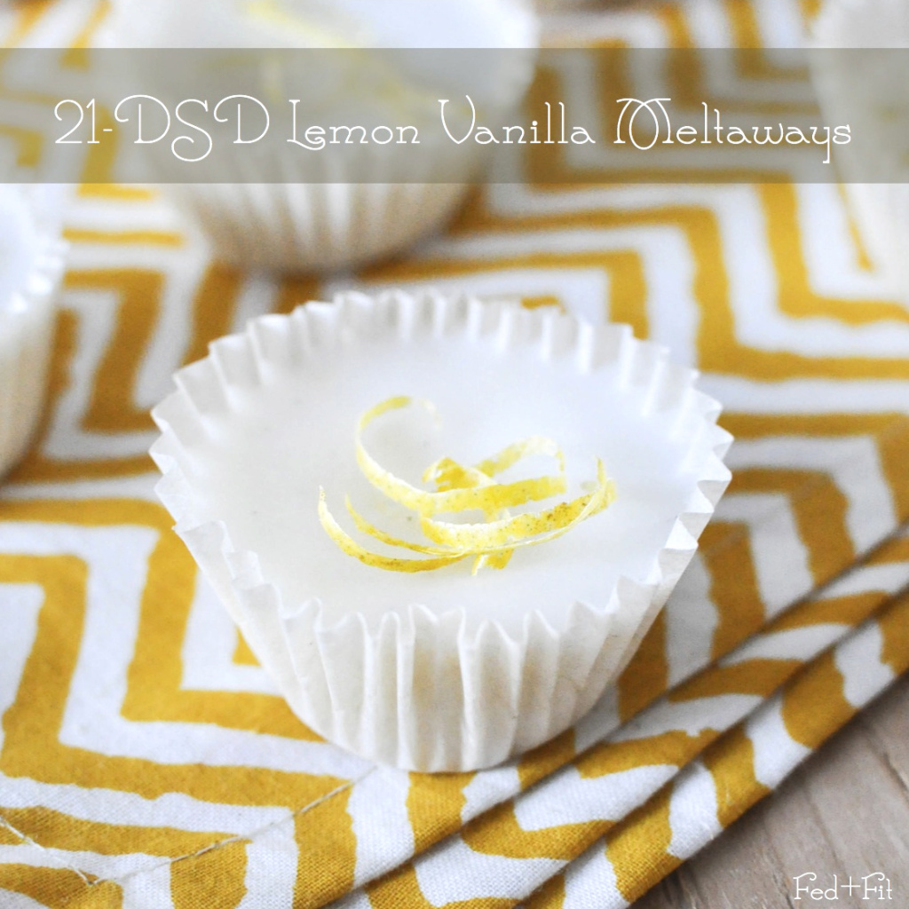 white lemon vanilla meltaways topped with lemon zest and placed on a yellow zig zag napkin