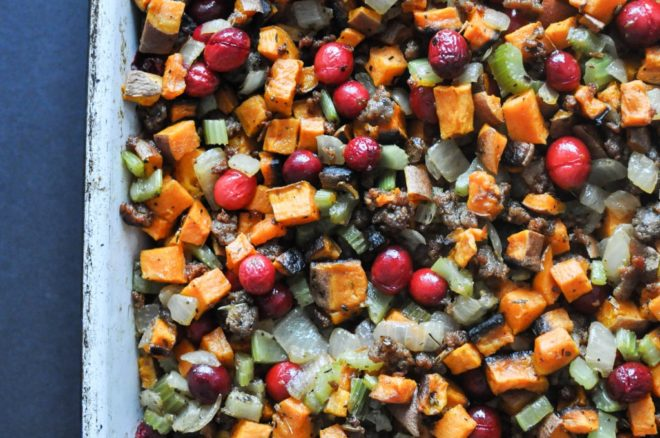 pan full of paleo stuffing with diced sweet potatoes, celery, onion, sausage, and cranberries