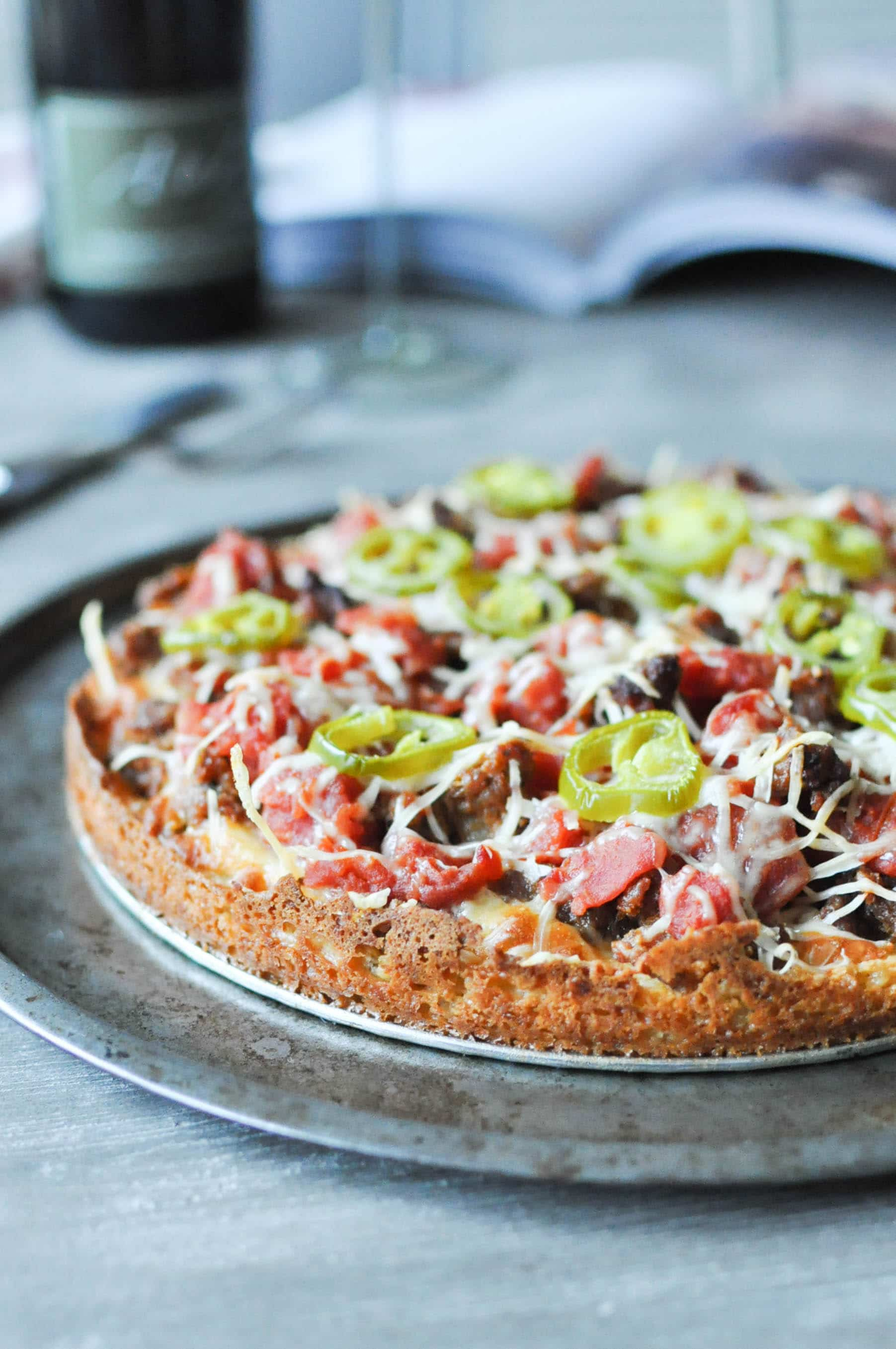 Chicago deep dish pizza on a round sheet pan