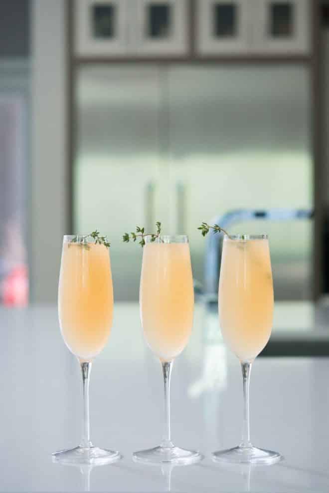 elderflower grapefruit mimosa in three champagne flutes