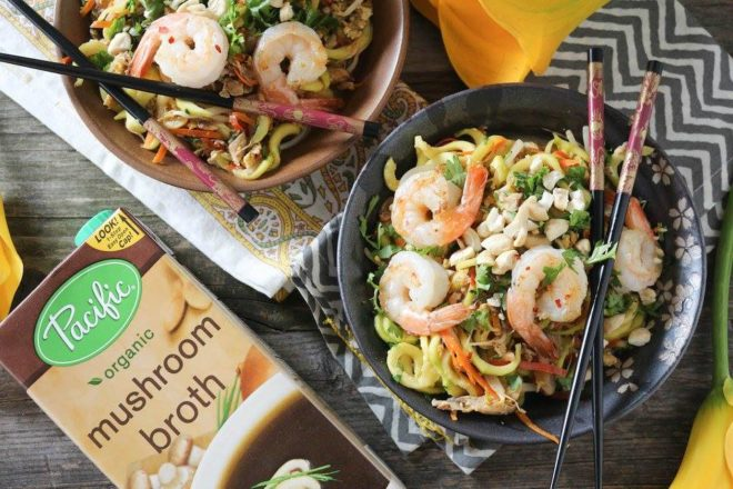 two bowls of shrimp and zucchini pad thai