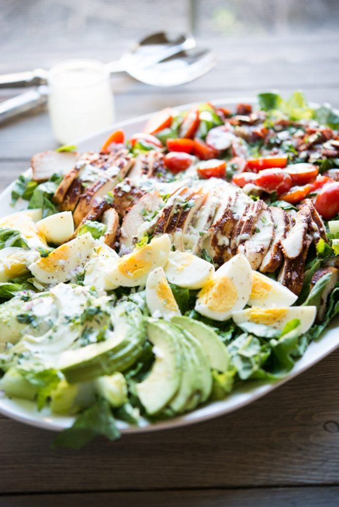 a plate of BBQ chicken Cobb salad with jalapeno ranch