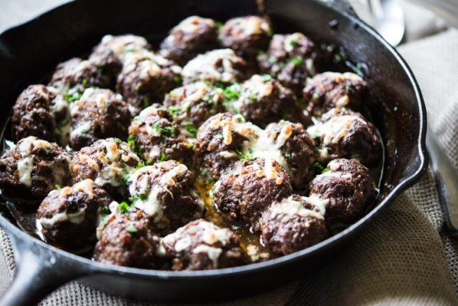 french onion skillet meatballs in a cast iron pan
