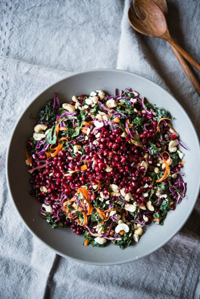 This winter veggie coleslaw is the perfect side salad with kale, cabbage, tangy pomegranate seeds, crunchy cashews, and an Asian-inspired dressing!