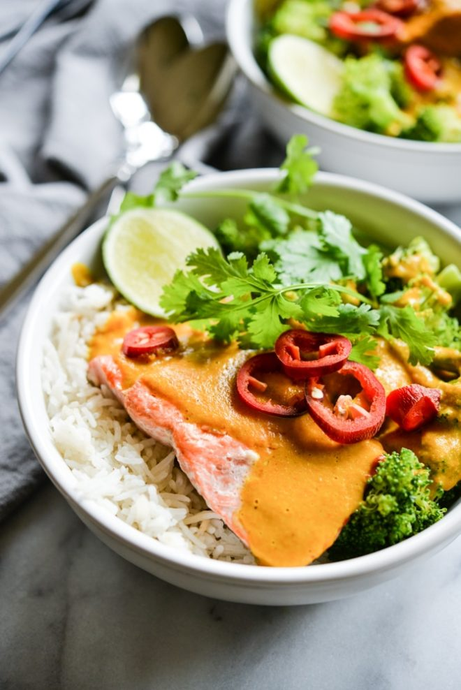 These easy bowl feature quick pan-seared salmon, an Indian coconut curry sauce, steamed broccoli, and rice for an easy one bowl dinner! | Fed & Fit
