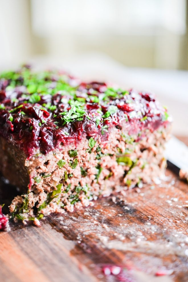 This Paleo bison cranberry meatloaf is the perfect healthy winter comfort food. It is incredibly flavorful, packs a big superfood punch, and the tangy cranberry sauce topping makes it perfectly festive for the holiday season!