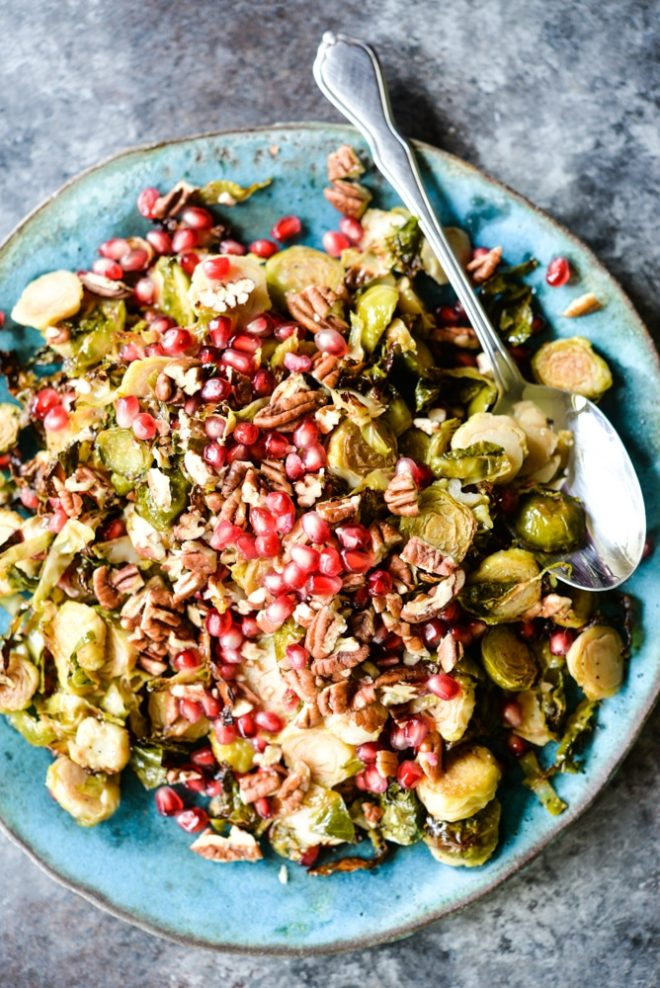 Brussels sprouts slaw features crispy shredded Brussels sprouts, tangy red wine vinaigrette, bright pomegranate seeds, and chopped pecans. It is the perfect winter side dish!