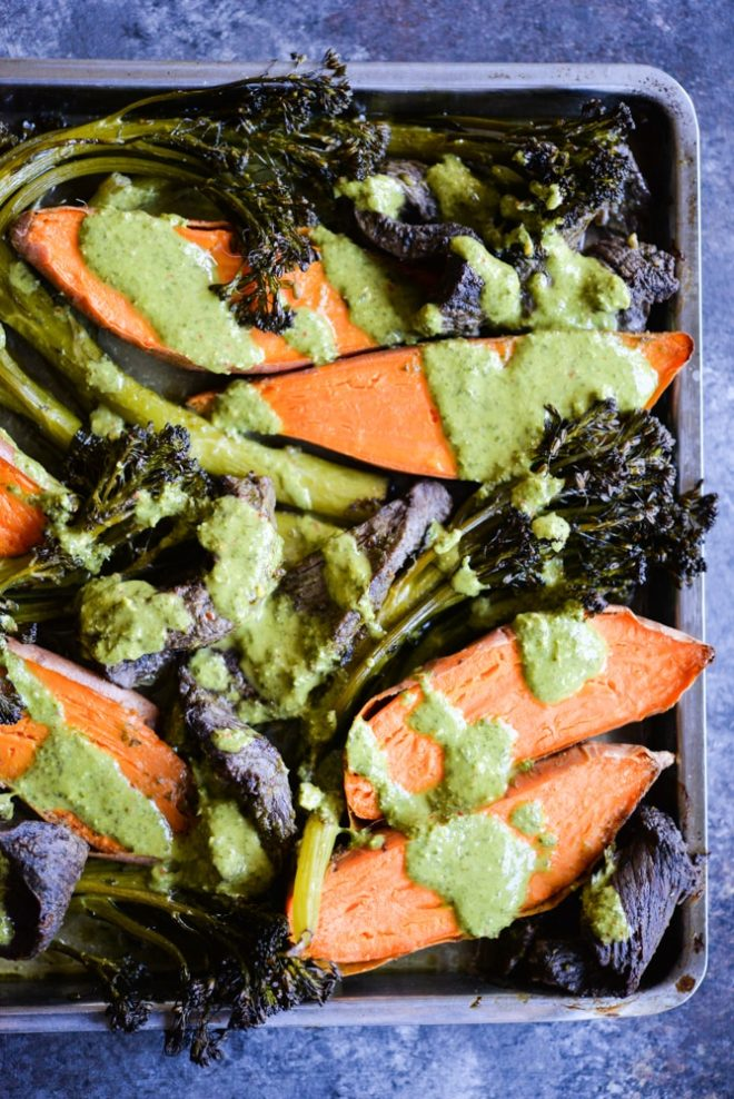 overhead view of chimichurri beef sheet pan dinner with beef, sweet potatoes, and broccolini