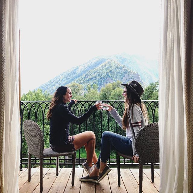 two women doing a cheers in Leavenworth, WA