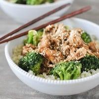 a white chicken teriyaki bowl with brown chopsticks - crockpot freezer meals