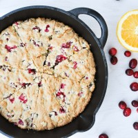 overhead view of cranberry orange scones in a cast iron skillet