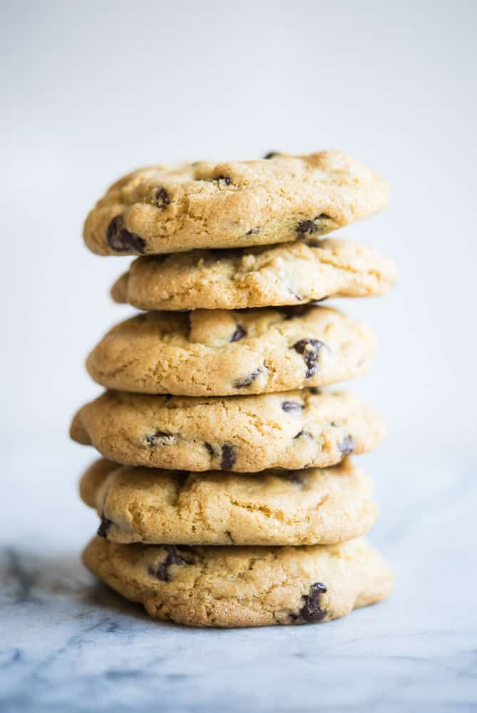 stack of chewy gluten free chocolate chip cookies on a marble table