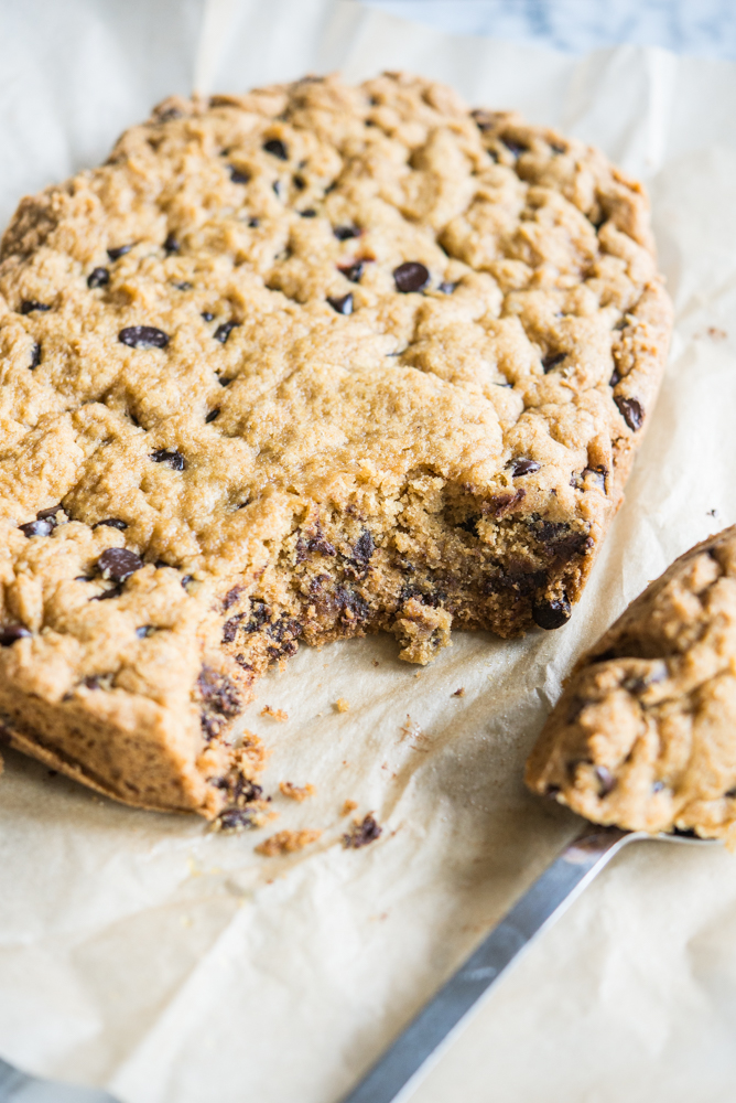 chocolate chip cookie cake on parchment paper