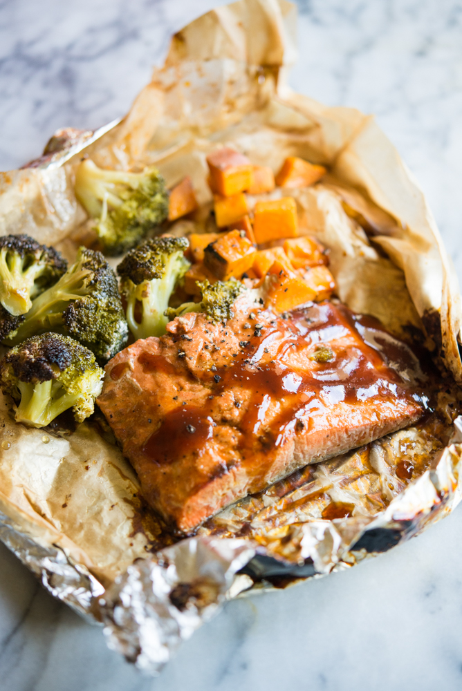 bbq salmon, sweet potatoes, and broccoli in parchment and foil for a grilled foil packet dinner