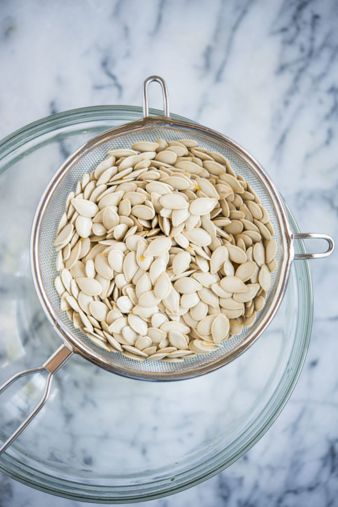 pumpkin seeds in a strainer