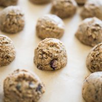 no-bake blueberry energy balls on parchment paper