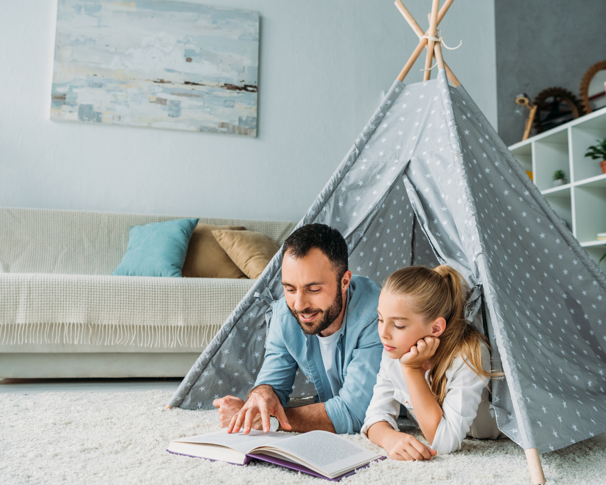 dad reading with daughter in a tent - activities for adults and kids