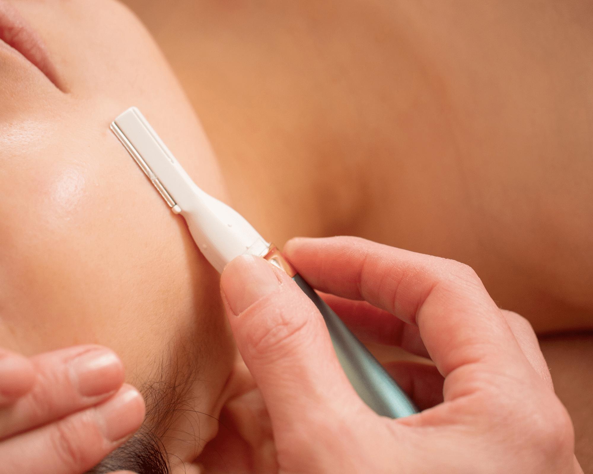 small razor shaving woman's face