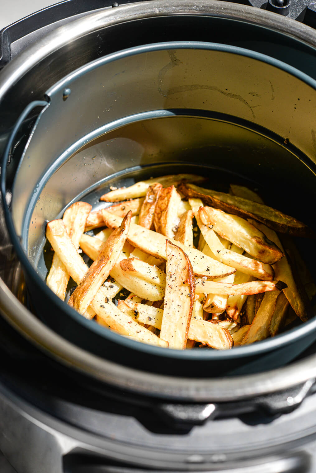 crispy french fries in an air fryer basket