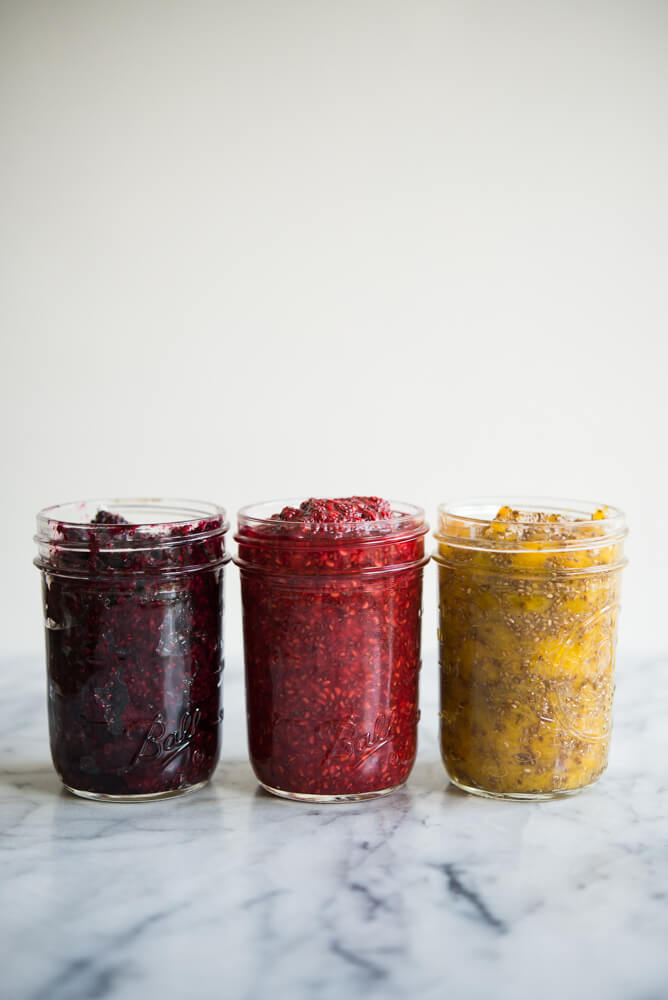 side view of 3 mason jars of different colored chia jam