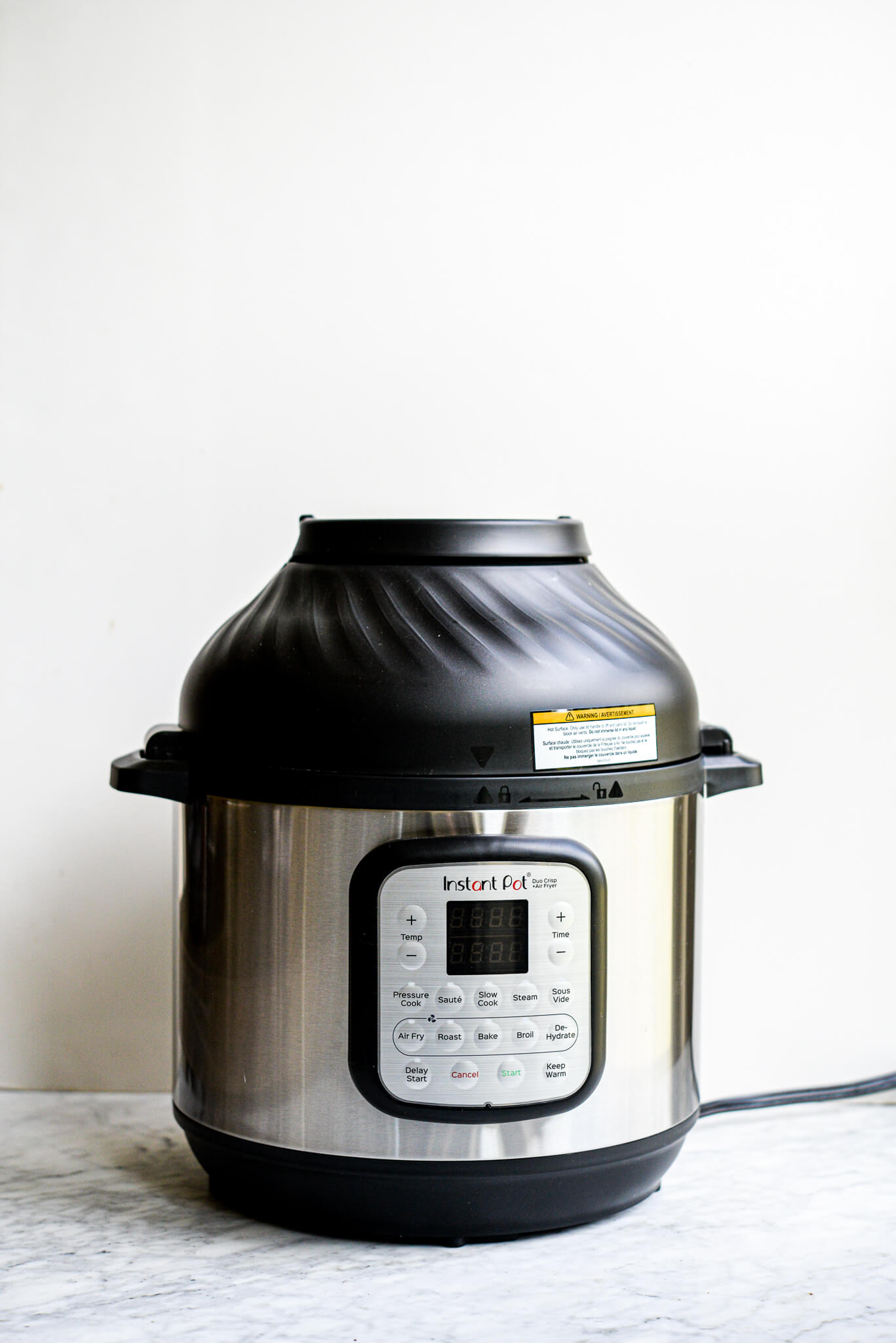 instant pot duo crisp with air fryer lid on a marble surface