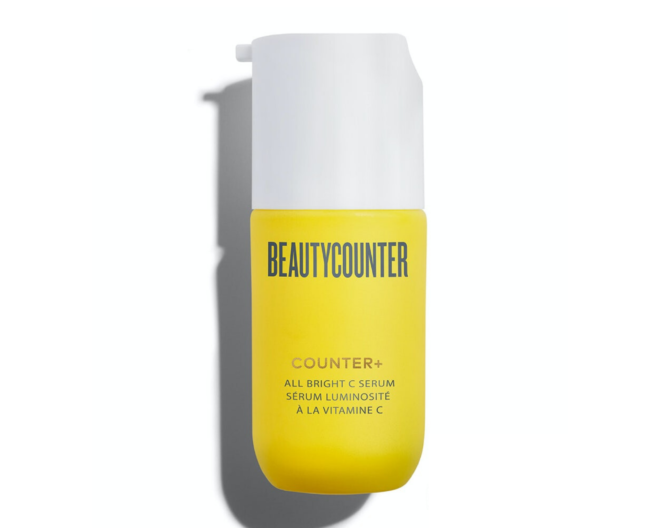 beautycounter all bright serum in a bright yellow and white bottle