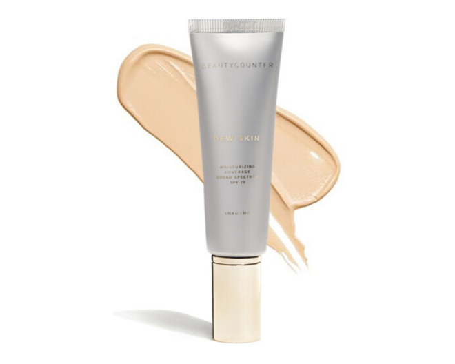 beautycounter dew skin foundation in silver and gold packaging