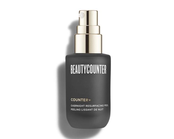 beautycounter overnight resurfacing peel in a dark gray and gold bottle