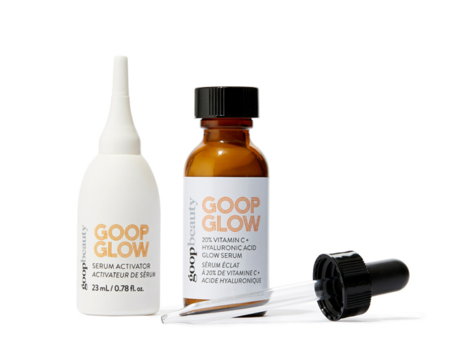 goopglow vitamin c serum in an opaque amber bottle next to a white bottle of serum activator