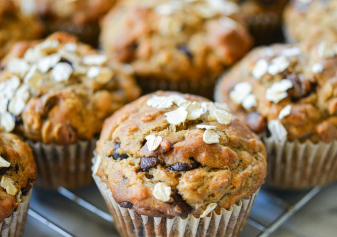 freshly baked chocolate chip banana oat muffins cooling on a cooling rack