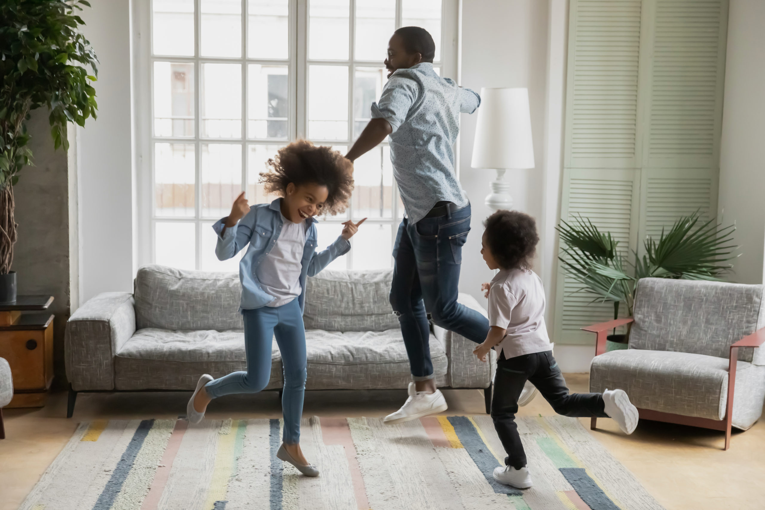 father and kids having a dance party in the living room