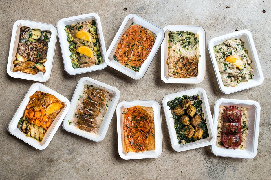 an assortment of balanced bites frozen meals on a concrete surface