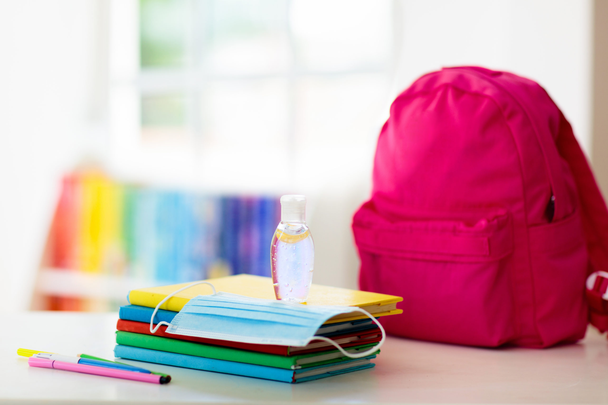 Backpack of school child with face mask and sanitizer. Student safety after coronavirus pandemic. Virus and disease prevention for kids. Back to school and kindergarten after covid-19 outbreak.