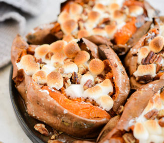 top view of a plate of marshmallow and pecan topped baked sweet potatoes