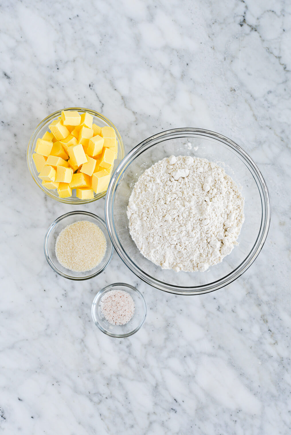the top view of ingredients for gluten free pie crust (flour, cubed butter, salt, and sugar)
