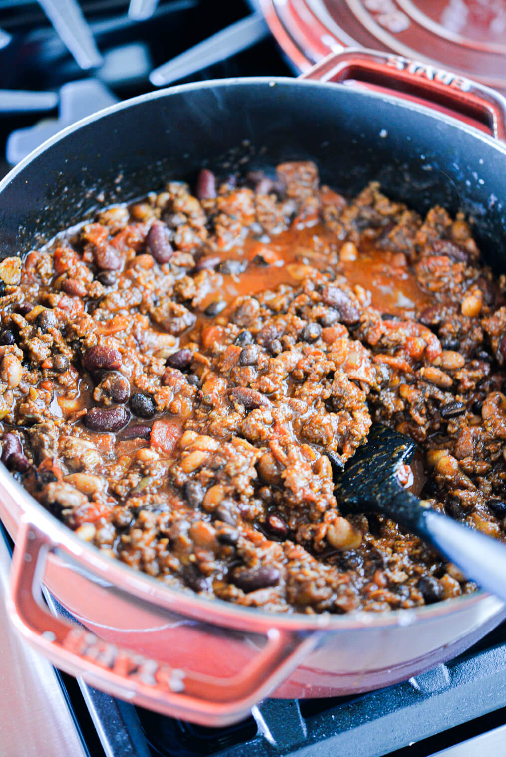 finished ground beef chili in a large red pot on the stovetop