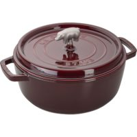 staub 6 quart round cocotte in red on a white background