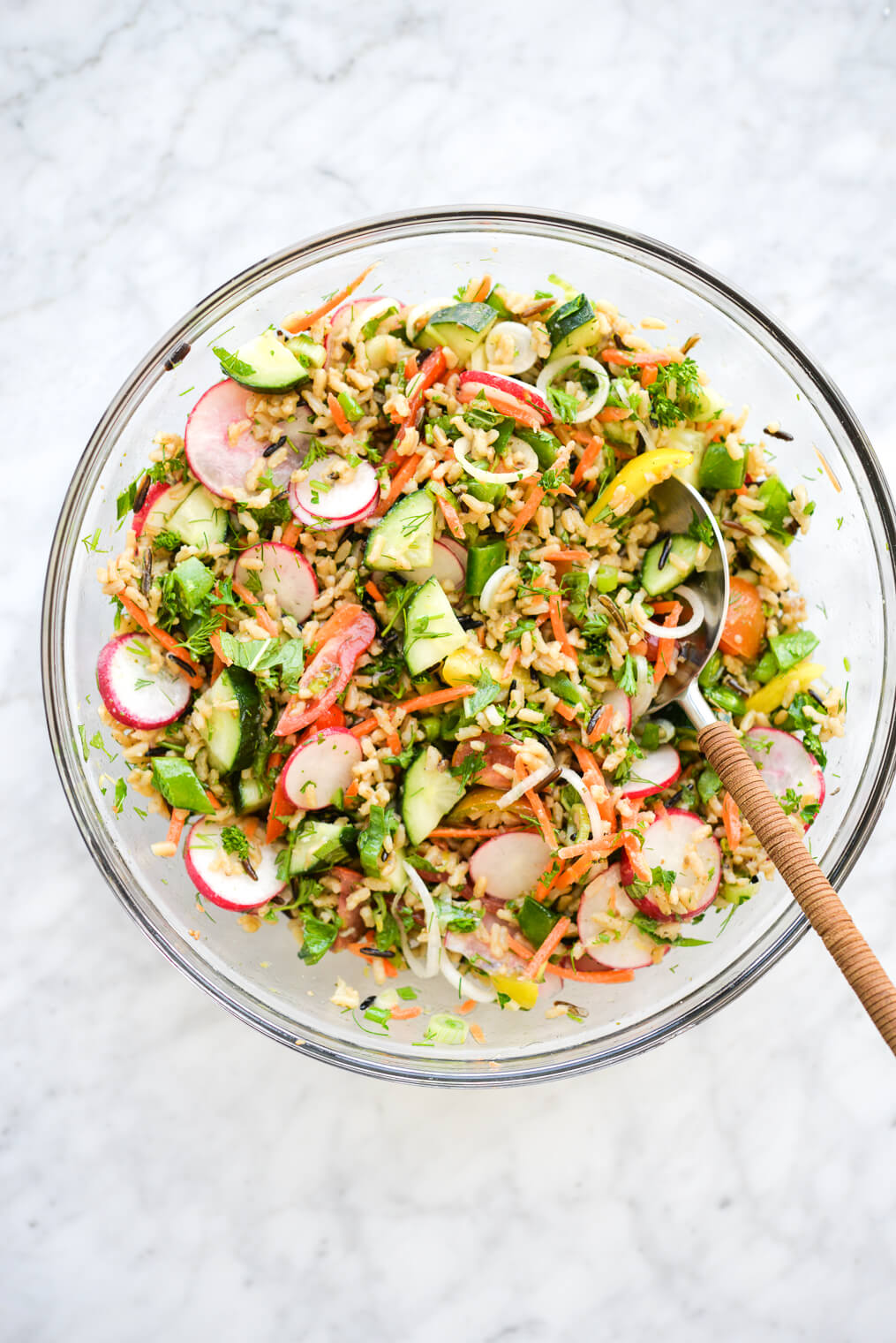 a large glass bowl of very colorful chilled spring veggie salad