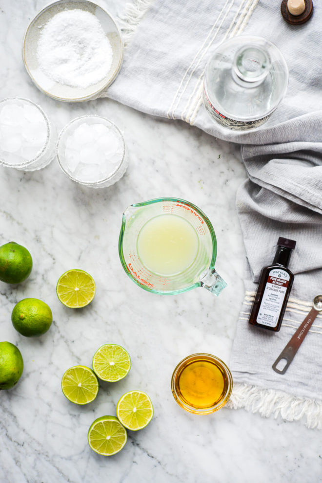 all of the ingredients for a skinny margarita sitting on a marble surface