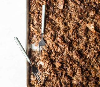 a sheet pan of crispy slow cooker pork carnitas