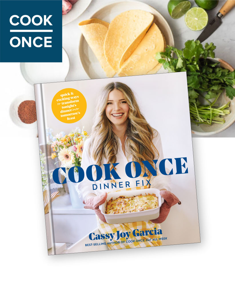 book cover with woman with light brown wavy hair in a white shirt holding a casserole dish with cook once dinner fix written in navy on the cover