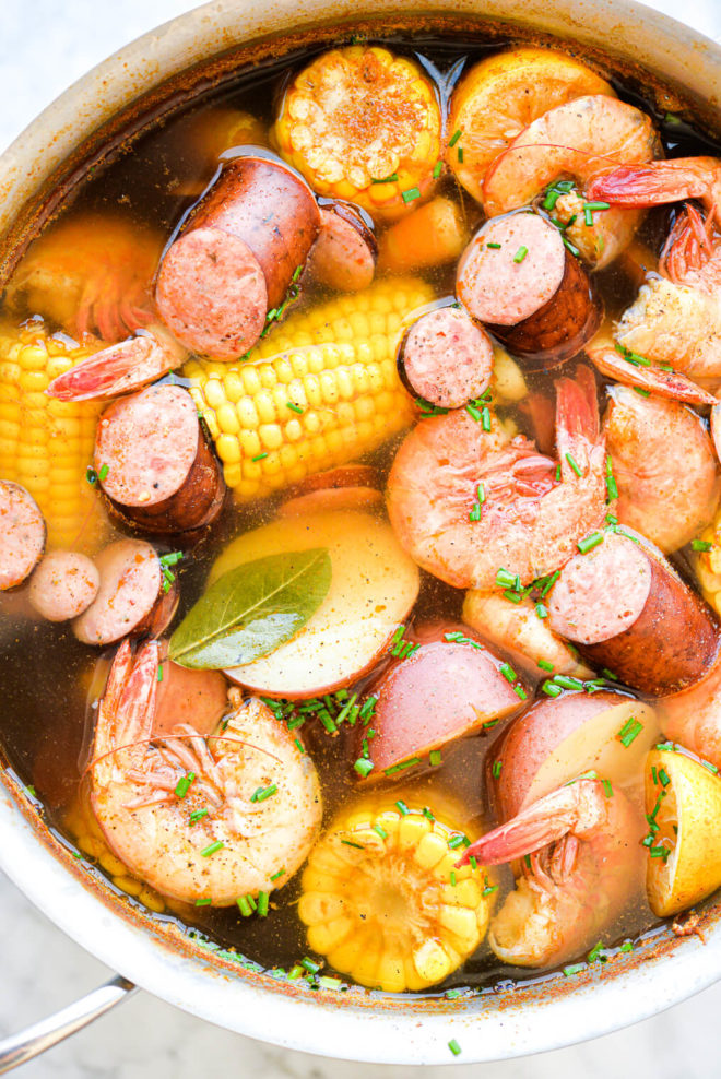 a large pot of shrimp, potatoes, corn, and sausage