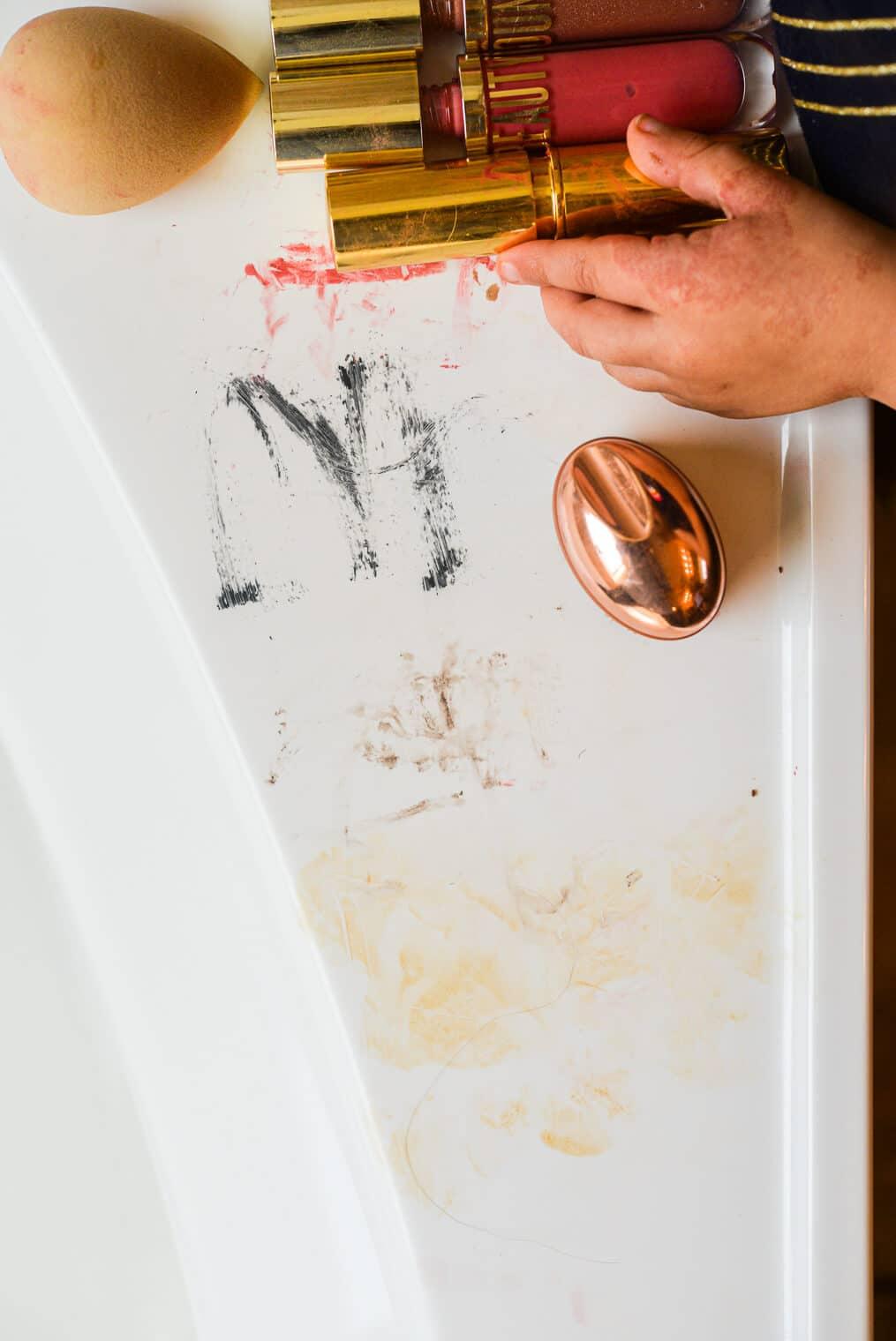 a bathroom tub covered on makeup smears